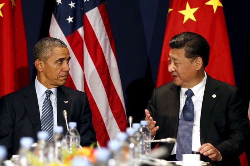 US President Barack Obama meets with Chinese President Xi Jinping at the start of the two-week climate summit on Nov 30, 2015.