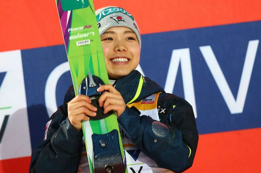 Japan's Sara Takanashi celebrates winning the individual normal hill event at the FIS women's ski jumping world cup in Oberstdorf, Germany on Sunday.