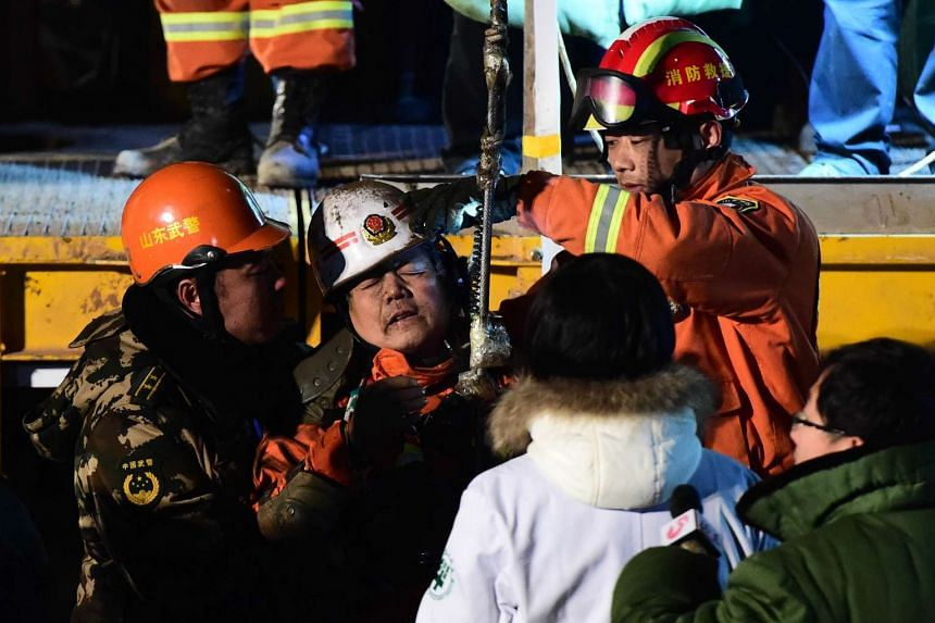 The trapped men were lifted one by one to the surface in a harness and then rushed to a hospital, accompanied by a crush of reporters and cameras, but were too weak to speak about their ordeal.