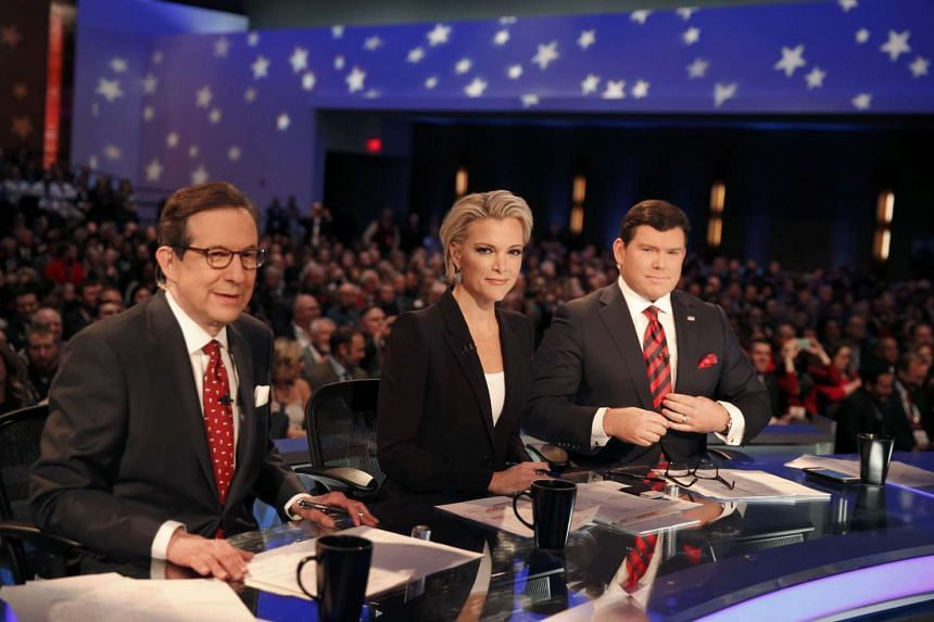 Fox News anchor and moderator Kelly (centre) and her colleagues during the US Republican presidential debate last Thursday. Businessman Trump had wanted Ms Kelly removed from the moderating panel.