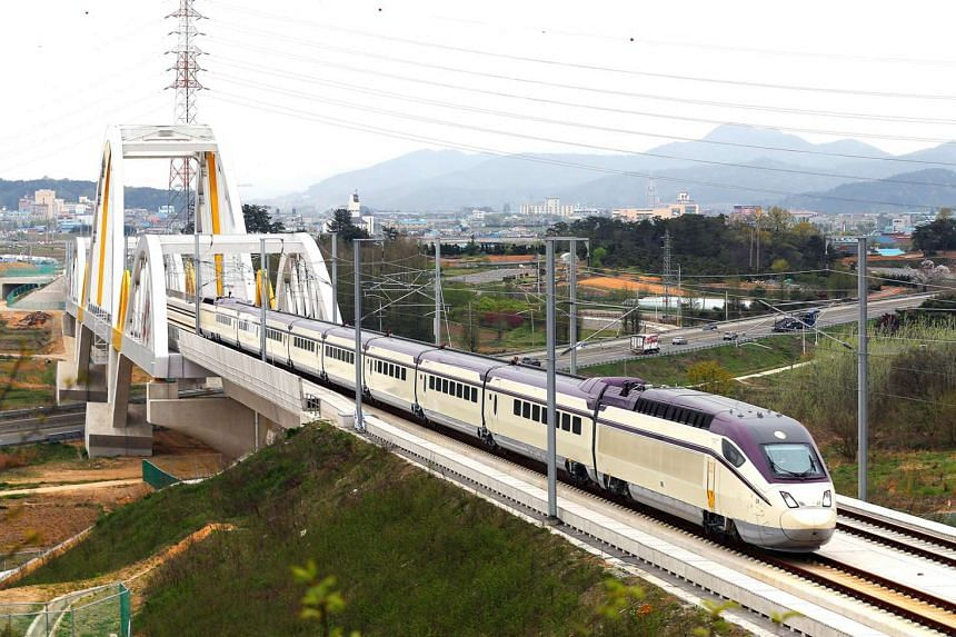 A bullet train on the Honam Line, which was opened last year to link South Korea's new administrative capital of Sejong City in the middle of the country to Gwangju in the north-west. About 150,000 people a day use the the country's high-speed ra