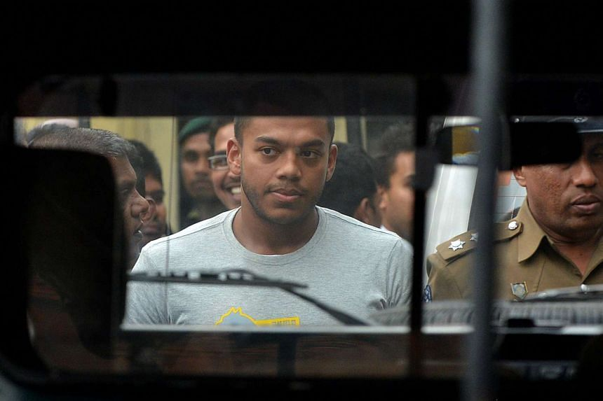 Yoshitha Rajapaksa being led to prison on Saturday. His bail application was rejected after he was questioned by the police and he was ordered to be detained for 14 days at a Colombo prison. He is the second member of his family to be arrested since