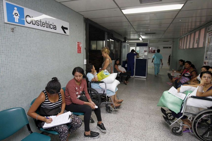 Two women (far left) infected with the Zika virus waiting at a hospital in Cucuta, Colombia. There are 20,297 confirmed cases of the disease in the country, the national health institute said.