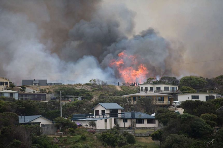 A bushfire raging behind Arthur River township in Tasmania on Thursday. Parts of the island's famed wilderness are being destroyed by fires which have been raging for more than two weeks.