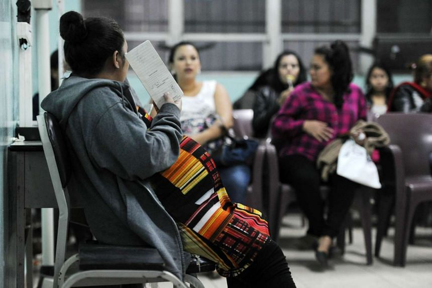Pregnant women await to be checked by a doctor at a clinic in Tegucigalpa, Honduras.