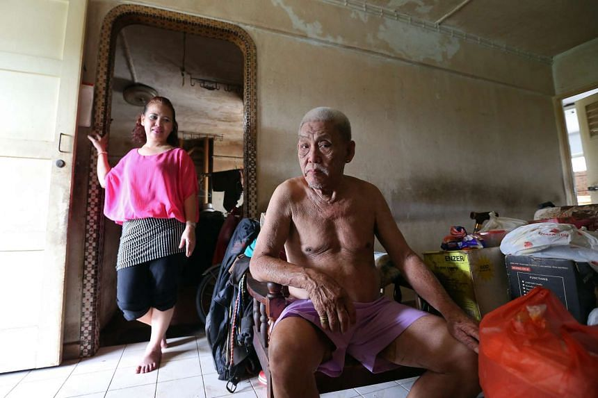 Madam Noriza A. Mansor with Mr Tan Soy Yong in his Potong Pasir flat in 2014.