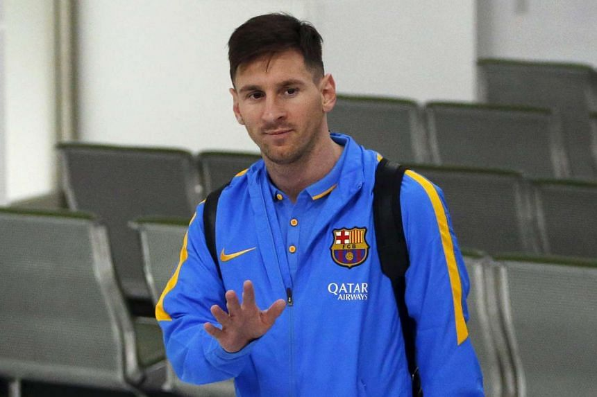 Barcelona's soccer player Lionel Messi walks upon his team's arrival at Narita International airport near Tokyo, Japan, on Dec 14, 2015.