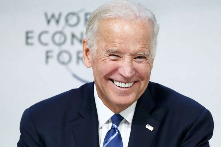 """US Vice President Joe Biden smiles during the session """"Cancer Moonshot: A Call to Action"""" during the annual meeting of the World Economic Forum in Davos, Switzerland on Jan 19, 2016."""