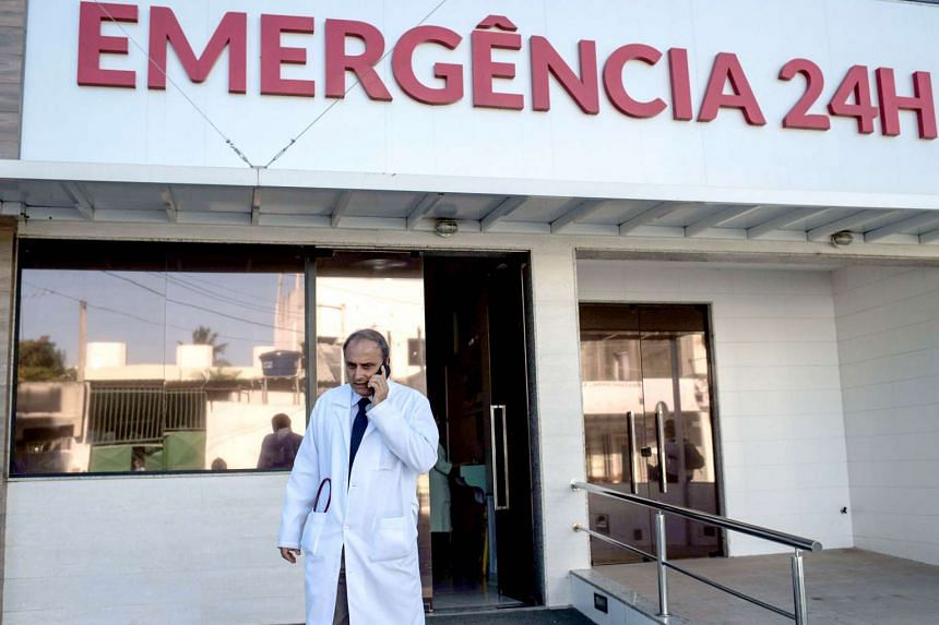 Brazilian infectologist Antonio Bandeira, who was part of the team of researchers who identified the Zika virus in Brazil, talks by mobile in front of the Santa Helena hospital in Camaçari, Bahia, Brazil on Jan 29, 2016.
