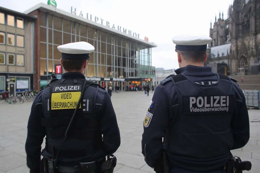 Officers of the German federal police patrol the main railway station equipped with body video cameras in Cologne, Germany, on Feb 1, 2016.