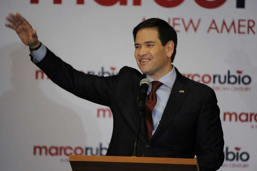 Mr Marco Rubio waves to supporters during the Rubio watch party in Iowa on Feb 1, 2016.