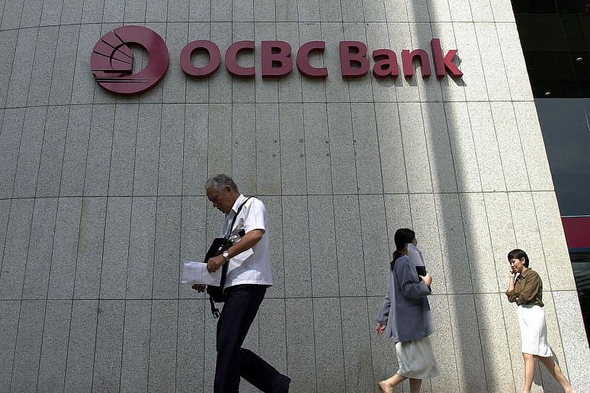 People walking outside the OCBC Bank Centre.