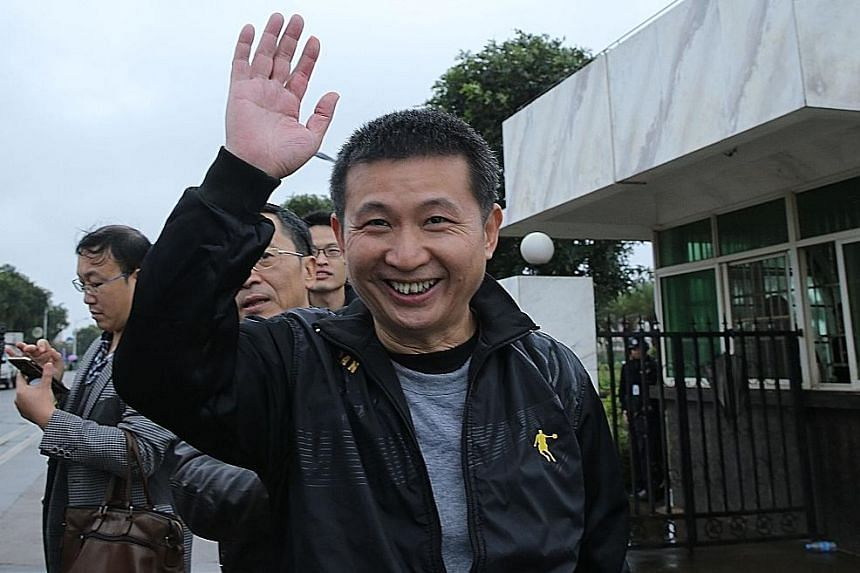 Mr Chen waving after being released from prison in Hainan yesterday. He had spent more than 20 years in jail before being acquitted due to lack of evidence.