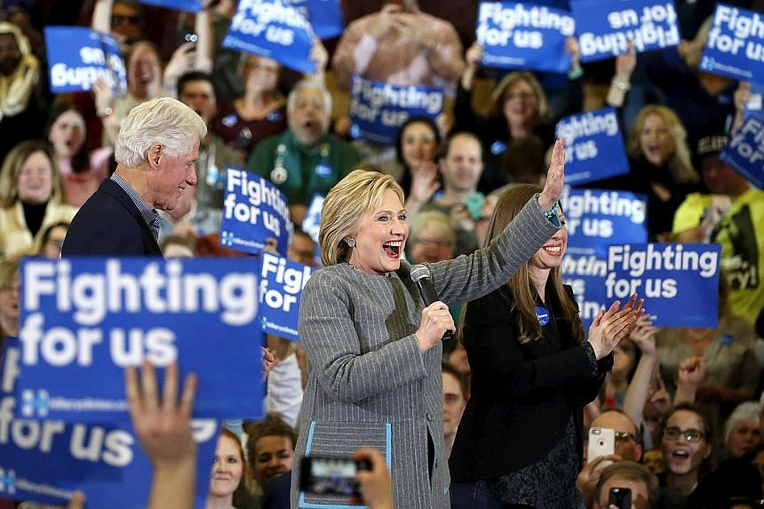 US Democratic presidential candidate Hillary Clinton on stage with her husband, former president Bill Clinton, and daughter Chelsea during a campaign rally at Abraham Lincoln High School in Des Moines, Iowa, on Sunday.