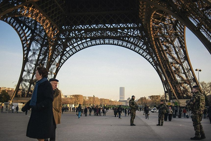 Soldiers on patrol at the Eiffel Tower in Paris last month. France is spending nearly €1 million (S$1.5 million) a day on heightened security across the country, part of a renewed surge in European military spending.