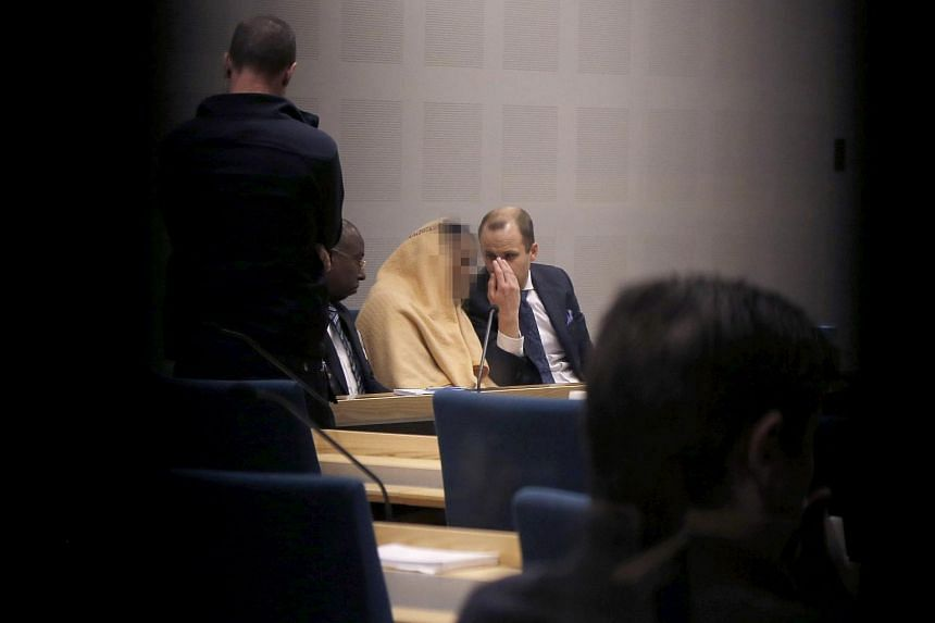 The 15-year-old suspect (pixelated) in the deadly stabbing of an asylum centre employee speaks with his lawyer Nicklas Unger during a hearing in the District Court of Gothenburg, on Jan 28, 2016.