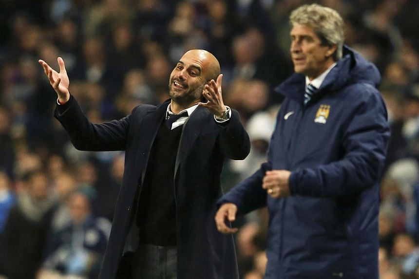 Bayern Munich coach Pep Guardiola (left) with Manchester City manager Manuel Pellegrini during a Champions League match in 2014.