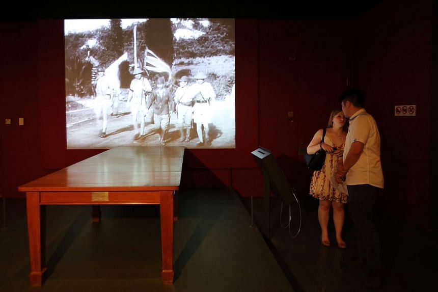 The Singapore Surrender table on display at the National Museum of Singapore.