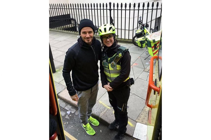 David Beckham (left) bought tea and coffee for a paramedic and her patient.