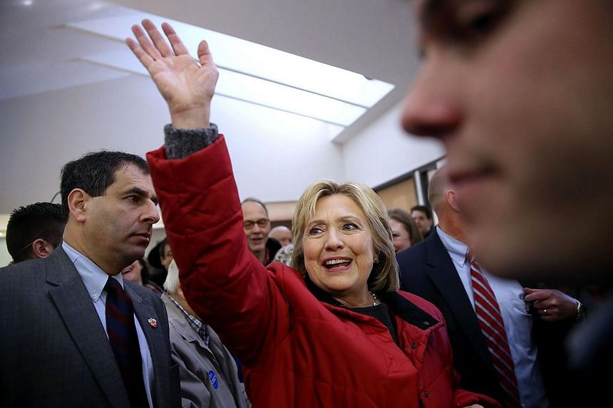 Democratic presidential candidate Hillary Clinton waves to supporters in Des Moines, Iowa.