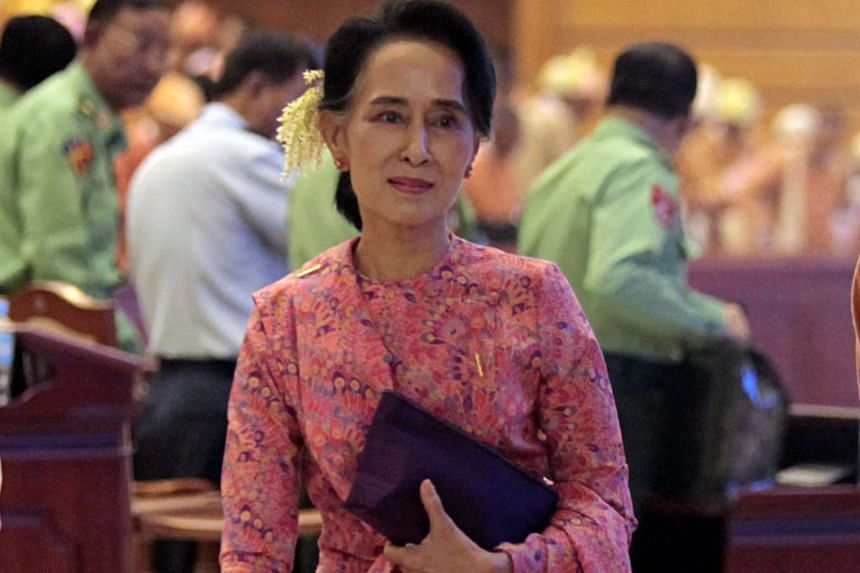 Myanmar democracy leader Aung San Suu Kyi leaves after a new parliament session on Feb 1, 2016.