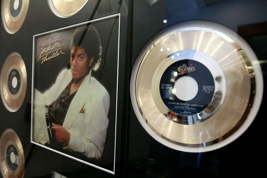 A framed display of gold records for Michael Jackson's Thriller album.