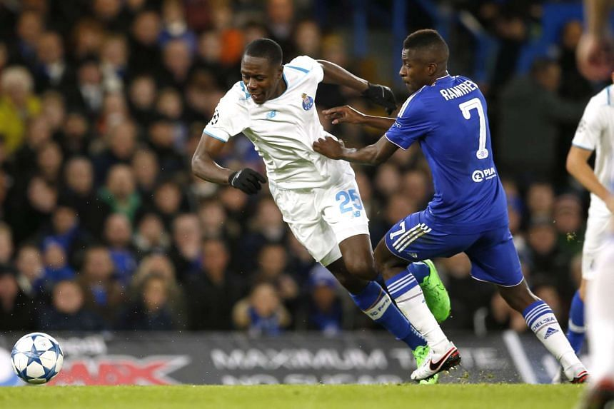 Chelsea's Ramires in action with Giannelli Imbula (left) during a Uefa Champions League Group Stage football match.