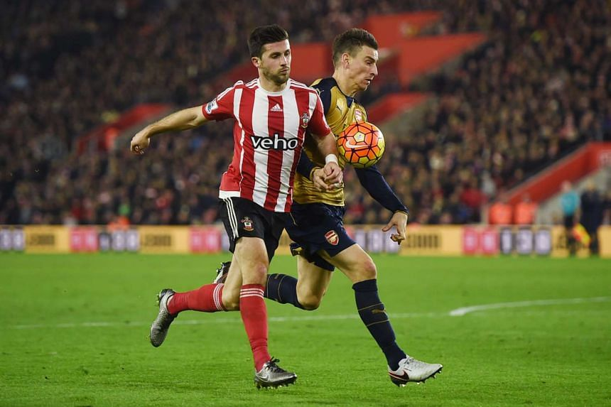 Arsenal's Laurent Koscielny in action with Southampton's Shane Long.