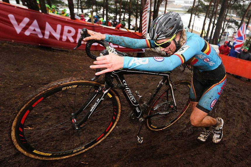 Femke van den Driessche competing at the 2016 cyclo-cross World Championships in Belgium on Saturday. Her bike was later found to have a hidden motor inside its frame.