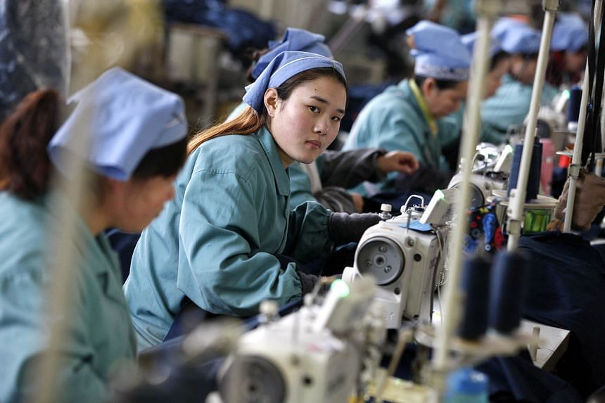 A garment factory in China. The country's purchasing managers' index fell to a three-year low of 49.4 last month, the National Bureau of Statistics said yesterday. It is the weakest index reading since August 2012. Numbers below 50 indicate contracti