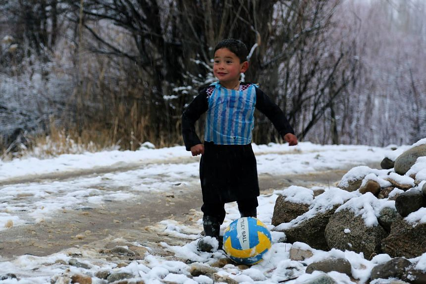 "Five-year-old Murtaza Ahmadi sporting the improvised jersey bearing the name and number of his favourite player, Lionel Messi. The Argentina star has pledged to ""do something"" for his young Afghan fan."