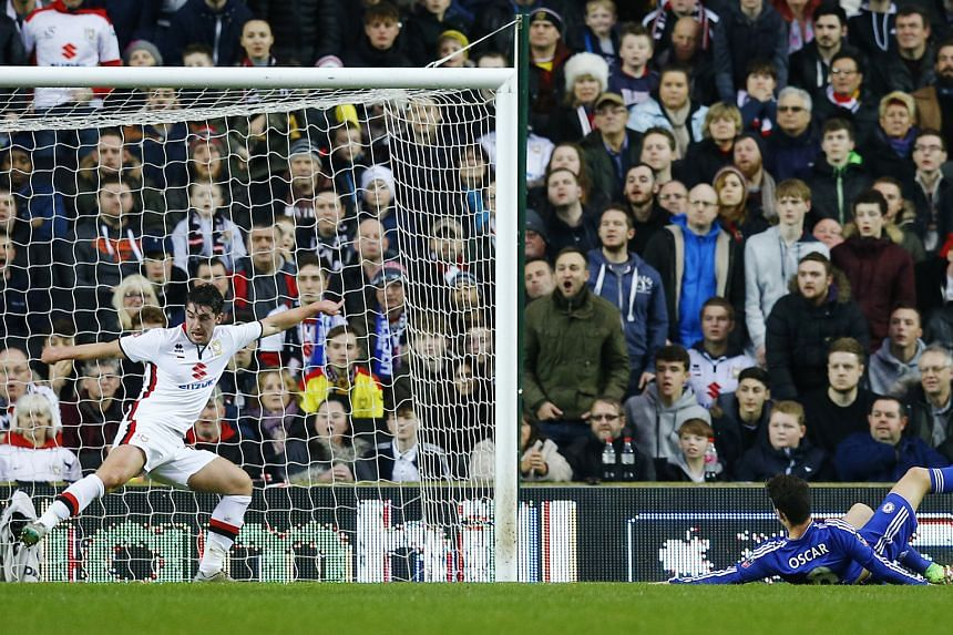 Chelsea's Oscar scoring their first goal against MK Dons in the FA Cup fourth round. The Blues won 5-1 with Oscar scoring a hat-trick.