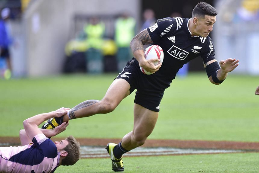 New Zealand's Sonny Bill Williams is tackled by Scotland's Scott Wight on the first day of the Wellington leg of the World Series rugby sevens tournament at the city's Westpac Stadium on Saturday.