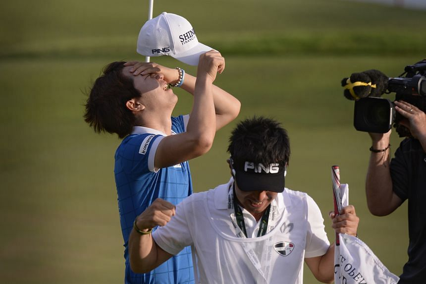 Song and his caddie celebrating after the 24-year-old South Korean held his nerve to make par on the 18th to win the SMBC Singapore Open.