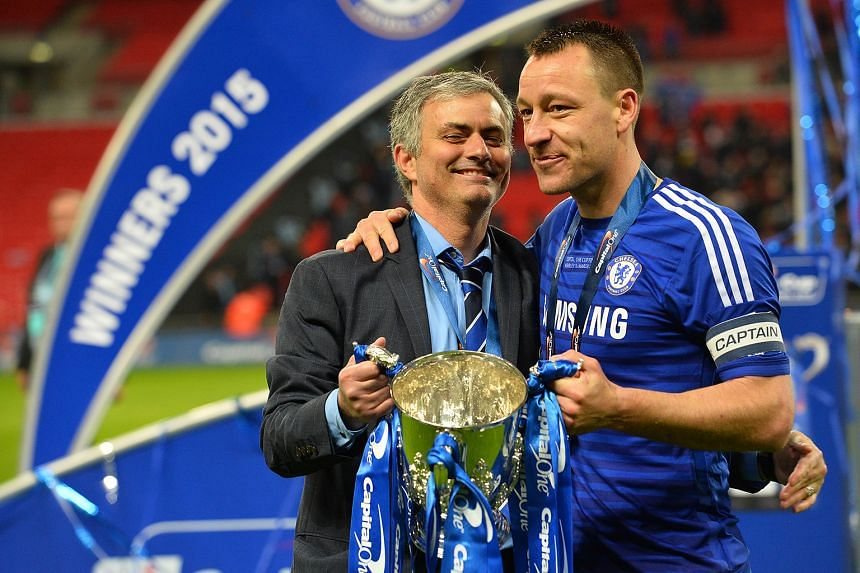 Chelsea captain John Terry enjoying happier times with former manager Jose Mourinho, lifting the League Cup last year.