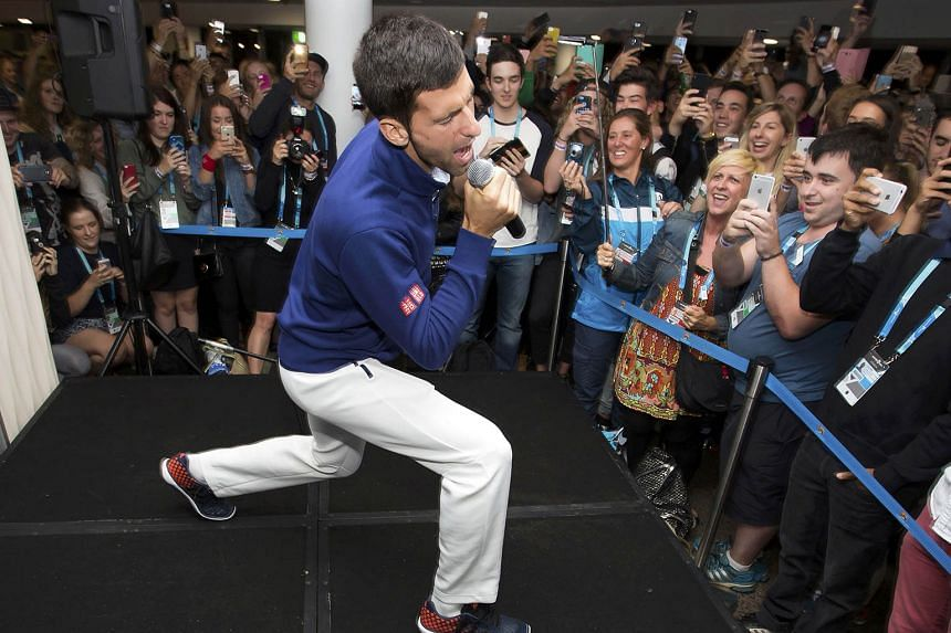 Novak Djokovic sings during a party for Melbourne Park staff. The world No. 1 was in celebratory mood after defeating Britain's Andy Murray in the Australian Open final on Sunday.