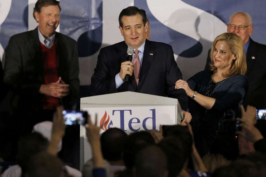 US Republican presidential candidate Ted Cruz speaking to the crowd, with his wife Heidi by his side, after winning at his Iowa caucus night rally on Feb 1, 2016.