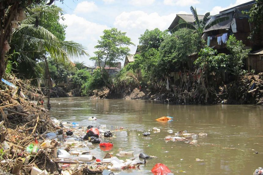 A riverview of the homes of illegal squatters at the riverbank in Kampung Melayu, East Jakarta.