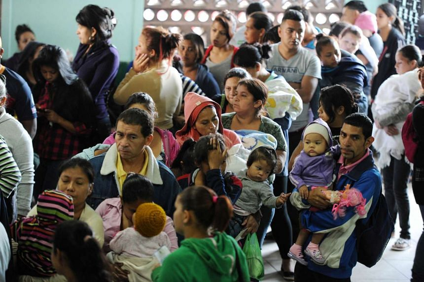Parents with their children at a hospital in Tegucigalpa, Honduras, on Feb 1.
