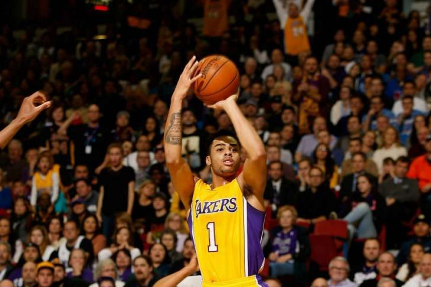 D'Angelo Russell of the Los Angeles Lakers shooting the ball against the Sacramento Kings.