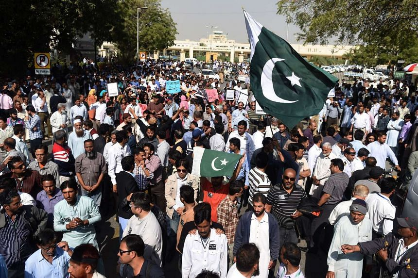 Employees of Pakistan International Airlines (PIA) march during a protest near Karachi International Airport in Karachi on Feb 2, 2016.
