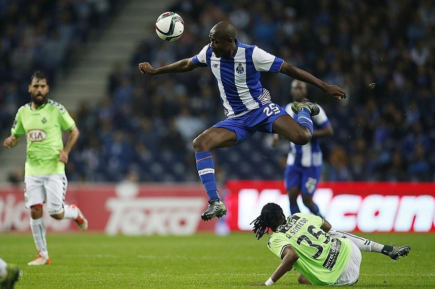 """Giannelli Imbula (top) in action for Porto against Vitoria Setubal's Ruben Semedo. Stoke City manager Mark Hughes likened his new signing to Patrick Vieira - """"a strong and powerful midfielder, a real driving force"""". The 23-year-old signed for Stoke j"""