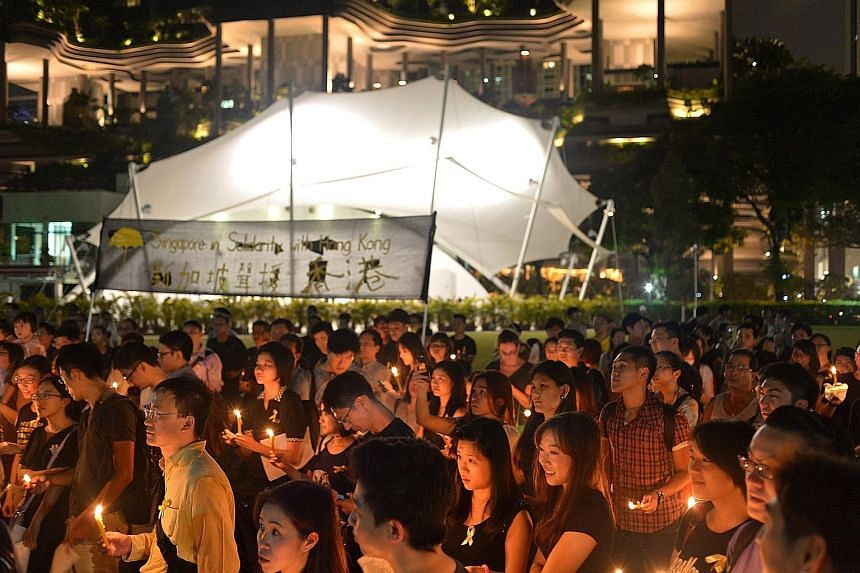 The vigil in October 2014 in Hong Lim Park to support protesters in Hong Kong fighting election restrictions, over which Mr Jolovan Wham was issued a police warning. According to Mr Wham's lawyer Choo Zheng Xi, the judge cut the legal costs sought by