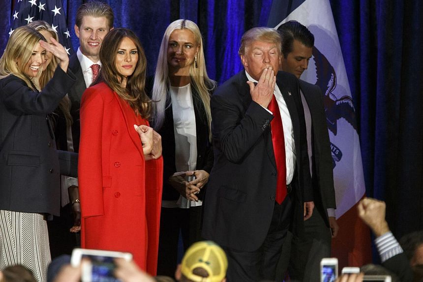 Republican presidential candidate Donald Trump (right) blows a kiss as he walks off stage in Iowa, on Feb 1, 2016.
