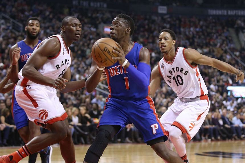 Detroit Pistons point guard Reggie Jackson (centre) looks for a play against the Toronto Raptors at Air Canada Centre.