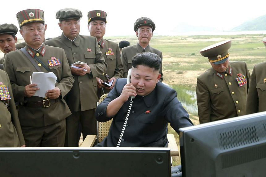 North Korean leader Kim Jung Un guiding the test fire of a tactical rocket in this undated photo released by the Korean Central News Agency on Aug 15, 2014.