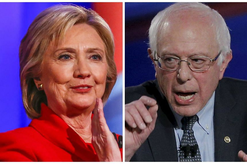Mrs Clinton (left) took 49.8 per cent of the vote, against 49.6 per cent for Mr Bernie Sanders.