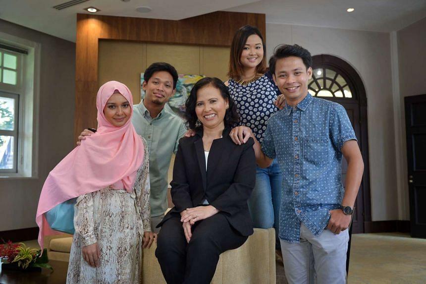 Straits Times Singaporean of the Year winner, Madam Noriza A. Mansor, 50, and her children.