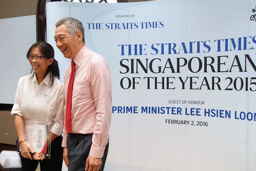 Straits Times Singaporean of the Year nominee Ms Wong Li Wai with PM Lee Hsien Loong at the award ceremony.