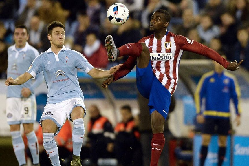 Jackson Martinez (right) vies with Celta Vigo's Serbian midfielder Nemanja Radoja during the Spanish Copa del Rey football match.